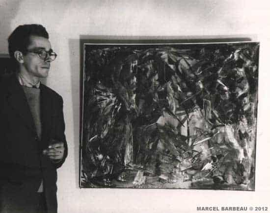 "Marcel Barbeau with his painting ""Fougue intermède gracile-toc"" ((1946)at the secon automatist exhibtion at the Gauvreau's, February 15 1947. Photo Fonds Maurice Perron du Musée national des Beaux-arts du Québec, kindly authorirized by Line-Sylvie Perron. Copyright © Carmen Perron."